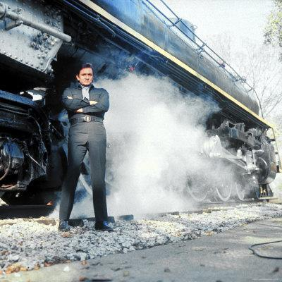https://imgc.allpostersimages.com/img/posters/country-music-star-johnny-cash-wearing-black-clothing-and-standing-in-front-of-a-locomotive_u-L-P478TT0.jpg?p=0
