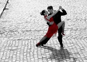 Couple dancing Tango on cobblestone road