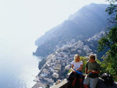 https://imgc.allpostersimages.com/img/posters/couple-reading-guidebook-on-lookout-above-town-positano-italy_u-L-P4FQ3F0.jpg?p=0