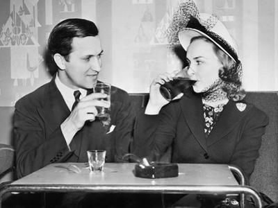 Couple Sitting Together in a Restaurant Flirting with Each Other
