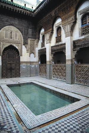 https://imgc.allpostersimages.com/img/posters/courtyard-sahrij-madrasa_u-L-PP9YR30.jpg?artPerspective=n