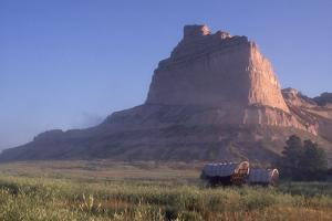 Covered Wagons on the Oregon Trail at Scotts Bluff, Nebraska, at Sunrise