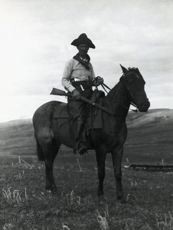 Cowboy on Horseback with Rifle