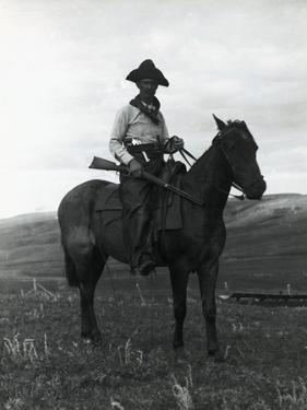 Cowboy on Horseback with Rifle