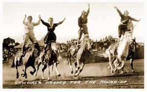 Cowgirls Standing on Horses