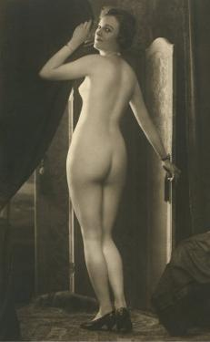 Coy Nude at Wardrobe Door