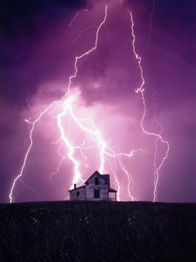 Lightning Behind a Farmhouse by Craig Aurness