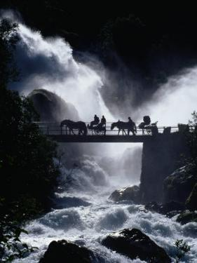 Pony Carts Crossing Bridge Over Waterfall and Rapids, Briksdal, Norway by Craig Pershouse