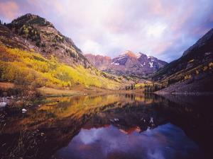Autumn Trees Encircling Mountain Lake at Dawn by Craig Tuttle