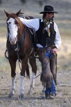 Cowboy Waiting with Horse by Craig Tuttle