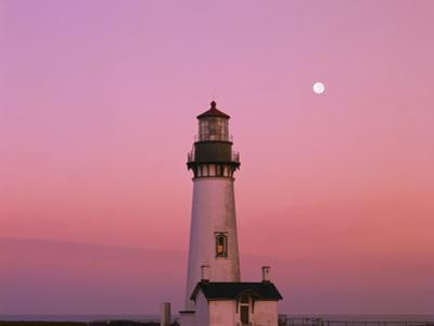 Lighthouse by Beach at Dusk by Craig Tuttle
