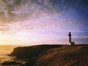 Sun Rising over Yaquina Head Lighthouse by Craig Tuttle