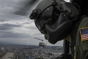 Crew Chief Scans the Area from a Uh-1N Huey Helicopter