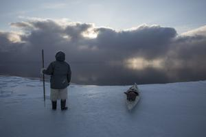 An Inuit Hunter on the Sea Ice by Cristina Mittermeier