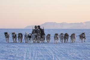 Inuit Hunters and Dog Sled Team on the Sea Ice by Cristina Mittermeier