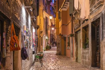https://imgc.allpostersimages.com/img/posters/croatia-istria-adriatic-coast-rovinj-old-town-lane-in-the-evening_u-L-Q11YHTY0.jpg?p=0