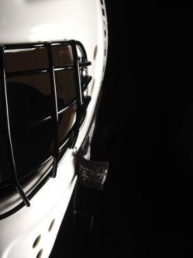 Cropped Studio Shot of Black and White Hockey Goalie's Mask