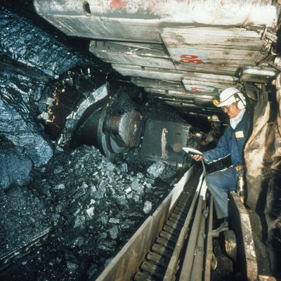 Technician Measures Noise Levels In a Coal Mine