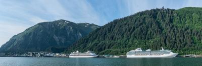 Cruise ship docked at a port with mountain the background, Juneau, Southeast Alaska, Alaska, USA
