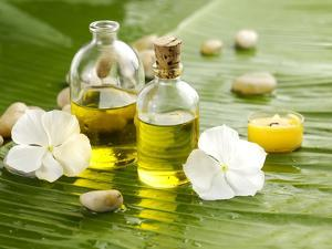 Health Spa with Massage Oil and White Flower ,Candle on Leaf by crystalfoto