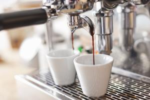Espresso Machine Pouring Cups of Coffee by Cultura/Nils Hendrik Mueller