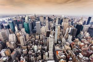 Aerial View of Manhattan Skyline at Sunset, New York City by Curioso Travel Photography