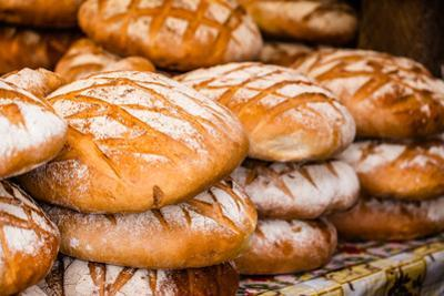 Traditional Bread in Polish Food Market in Krakow, Poland. by Curioso Travel Photography