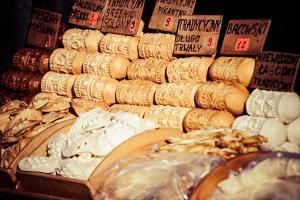 Traditional Polish Smoked Cheese Oscypek in Outdoor Market in Zakopane by Curioso Travel Photography
