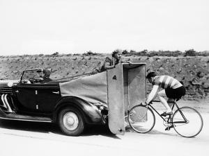 Cyclist Training Behind an Auburn Car, C1935