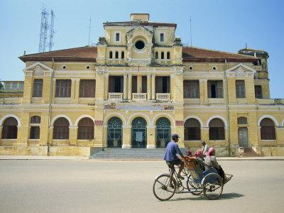 https://imgc.allpostersimages.com/img/posters/cyclo-passing-the-old-post-office-in-phnom-penh-in-cambodia-indochina-southeast-asia_u-L-P7O1KW0.jpg?p=0