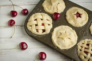 A Tin Filled with Small Fresh Cherry Pies Ready to Go into the Oven by Cynthia Classen
