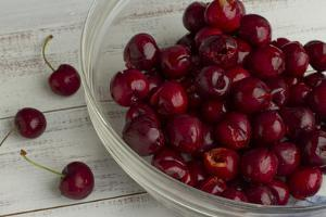 Fresh, Pitted Red Cherries in a Glass Bowl by Cynthia Classen