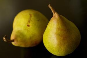 Two Comice Pears Sit Elegantly on a Black Background by Cynthia Classen