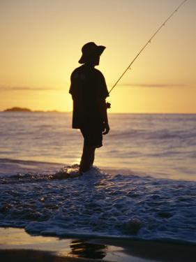 Fishing from the Beach at Sunrise, Australia by D H Webster