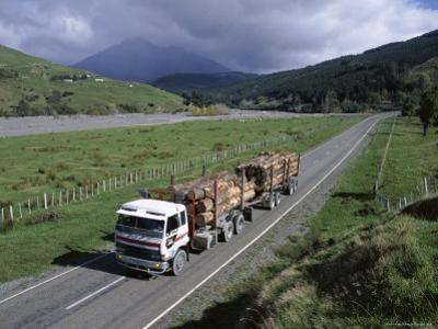 Logging Trucks on the Road Near Gisborne, East Coast, North Island, New Zealand
