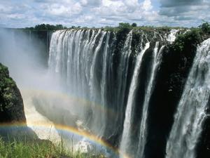 Waterfalls and Rainbows, Victoria Falls, Unesco World Heritage Site, Zambia, Africa by D H Webster
