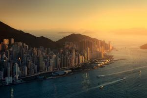 Sunset over Cityscape along Coastline of Island by d3sign