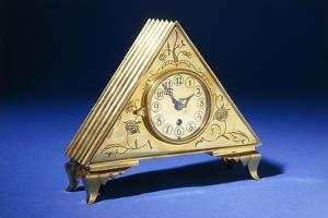 A Triangular Brass Table Clock with Engraved Floral Decoration by Dagobert Peche
