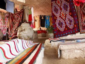 Display of Local Cloths and Carpets, Mides Oasis, Tunisia, North Africa, Africa by Dallas & John Heaton