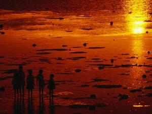 Children Silhouetted at Sunset, Ko Samui, Surat Thani, Thailand by Dallas Stribley