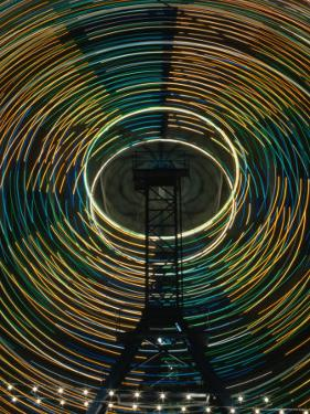 Lights of the Ferris-Wheel at the Royal Melbourne Agricultural Show, Melbourne,Victoria, Australia by Dallas Stribley