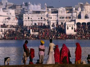 Pilgrims on Ghats of Pushkar Lake, Pushkar, Rajasthan, India by Dallas Stribley