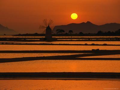 Sunset Over the Saltpans and a Windmill on San Pantaleo, Sicily, Italy