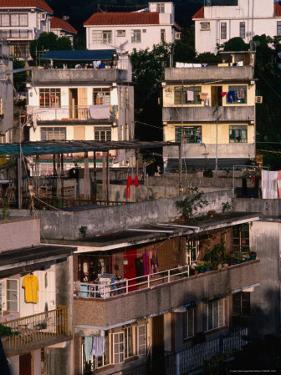 Village Scene at Yung Shue Wan Village, Lamma Island, Hong Kong by Dallas Stribley