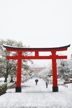 Entrance path to Fushimi Inari Shrine in winter, Kyoto, Japan, Asia by Damien Douxchamps