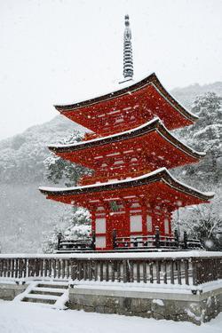 Snow falling on small red pagoda, Kiyomizu-dera Temple, UNESCO World Heritage Site, Kyoto, Japan, A by Damien Douxchamps