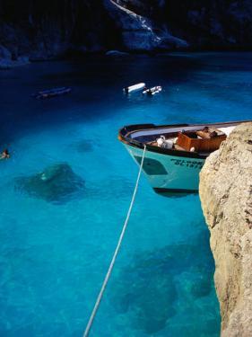 Boat in Water of Cala De Mariolu, Golfo Di Orosei, Italy by Damien Simonis