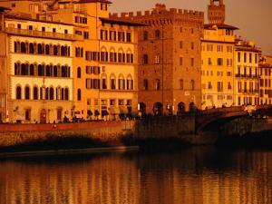 Buildings and Bridge along Arno River at Sunset, Seen from Oltrarno (South Bank), Florence, Italy by Damien Simonis