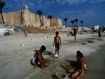 Children Playing on Beach in Front of Restored Fort Ribat, Monastir, Tunisia
