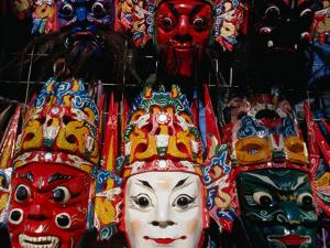 Souvenir Masks for Sale at Yonghe Gong (Lama Temple), Beijing, China by Damien Simonis